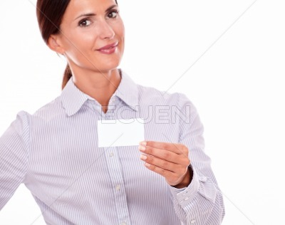 Smiling brunette businesswoman with visit card