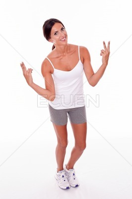 Smiling brunette woman gesturing peace signs