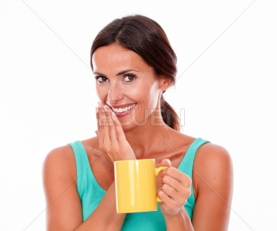 Smiling brunette woman with coffee mug