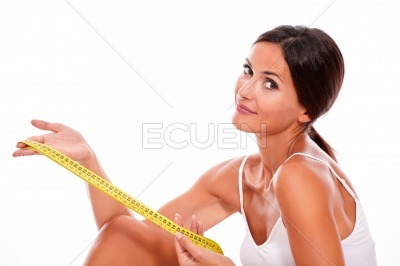 Smiling brunette woman with tape measure