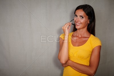 Smiling operator woman talking on headset