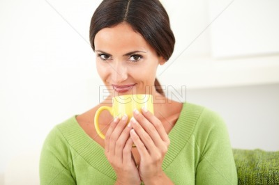 Smiling woman holding a yellow mug