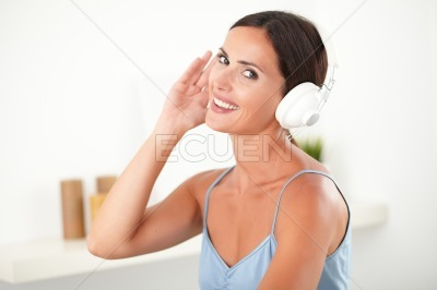 Sophisticated woman with headphones looking happy