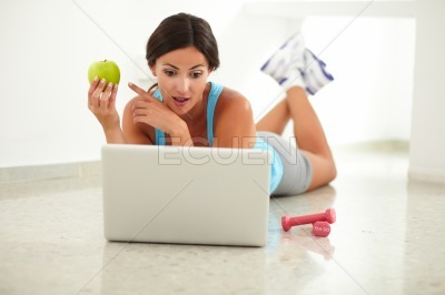Sporty young female surfing the web