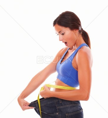 Sporty young lady measuring weight loss