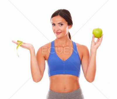Standing young woman trying weight loss