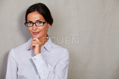 Straight hair lady with hand on chin and hair back