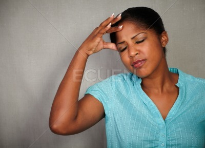 Stressed woman holding one hand on her head