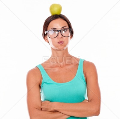 Stressed woman with an apple on her head
