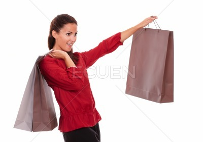 Stylish adult lady with paper bag