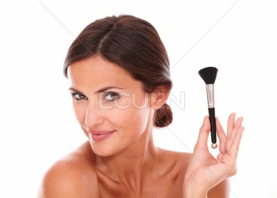 Stylized latin woman with make up brush
