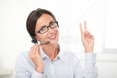 Successful businesswoman speaking on the earphone
