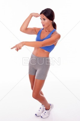 Surprised brunette woman pointing and gesturing