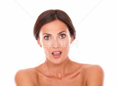 Surprised charming woman looking at camera