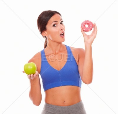 Surprised slim lady holding tempting food