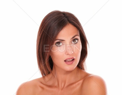 Surprised young woman with nude shoulders
