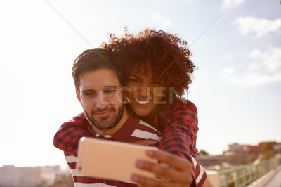 Sweet playful young couple taking selfies