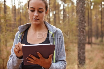 Sweet young girl with her tablet