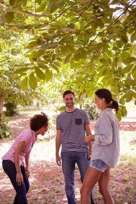 Three friends joking and laughing together