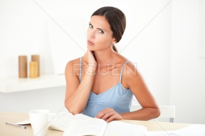 Tired lady in blue blouse studying her books