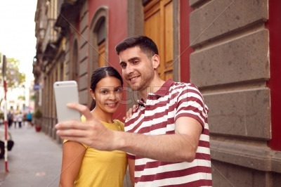 Very happy young couple taking a selfie