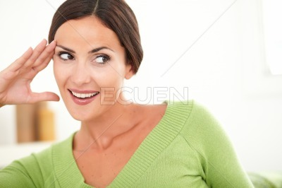 Woman with toothy smile looking away