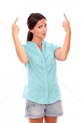 Young adult woman with finger pointing up