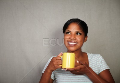 Young african woman holding a tea cup