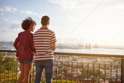 Young couple looking out at the bay