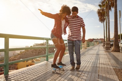 Young couple out for skateboard lessons