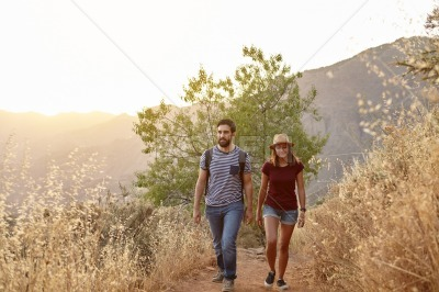Young couple strolling in the mountains