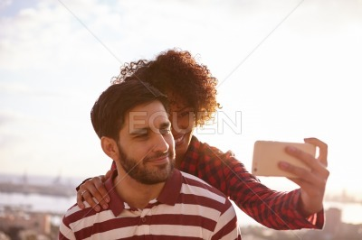 Young couple taking a fun selfie