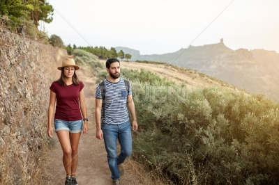 Young couple with backpack and straw hat