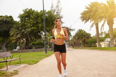 Young female doing sport outside in summertime