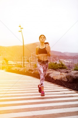 Young female jogger near the beach