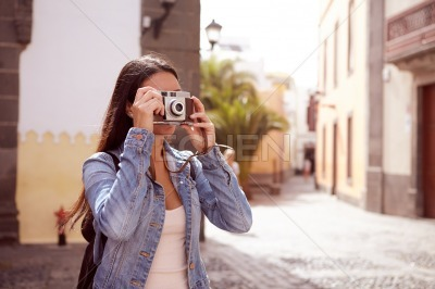 Young girl focusing her old camera