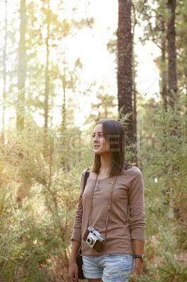 Young girl in a pine forest