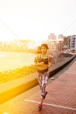 Young girl running in the city