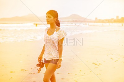 Young girl strolling on the beach
