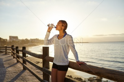 Young jogger drinking an energy drink