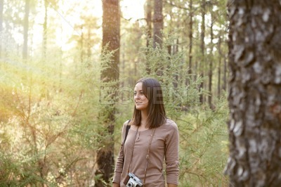 Young lady in a pine forest