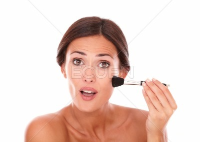 Young latin woman applying facial care product