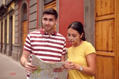 Young tourist couple trying to locate themselves