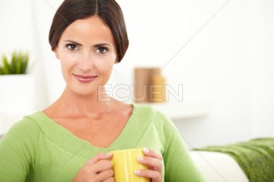Young woman holding a coffee mug