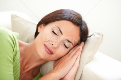 Young woman with closed eyes lying down