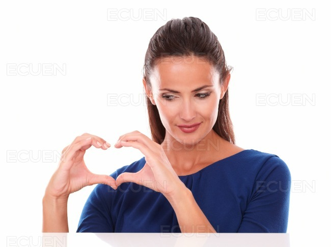 Attractive hispanic looking at a love sign