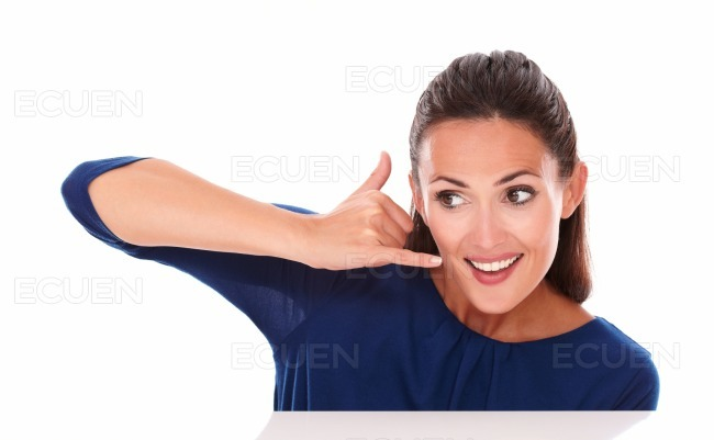 Charming girl gesturing a phone call
