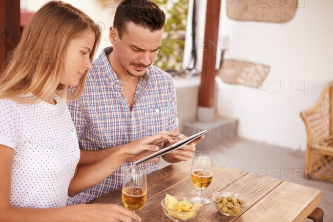 Concentrating couple with touchpad and beers
