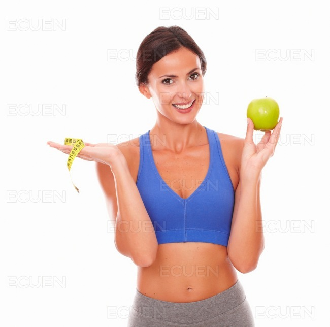 Energetic sporty woman dieting on fruit stock photo