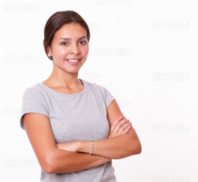 Friendly hispanic lady with crossed arms